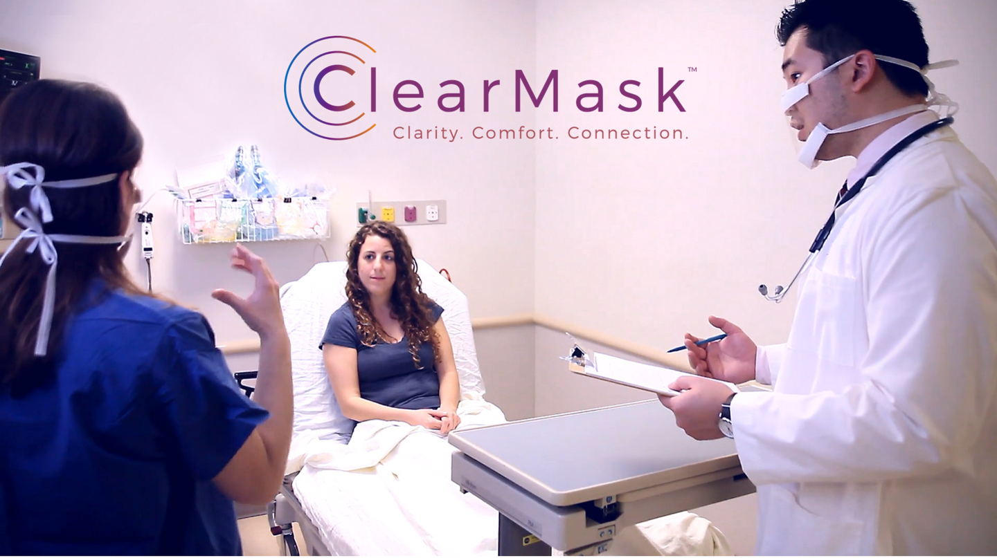 A photo of a doctor using ClearMask in a room with a patient